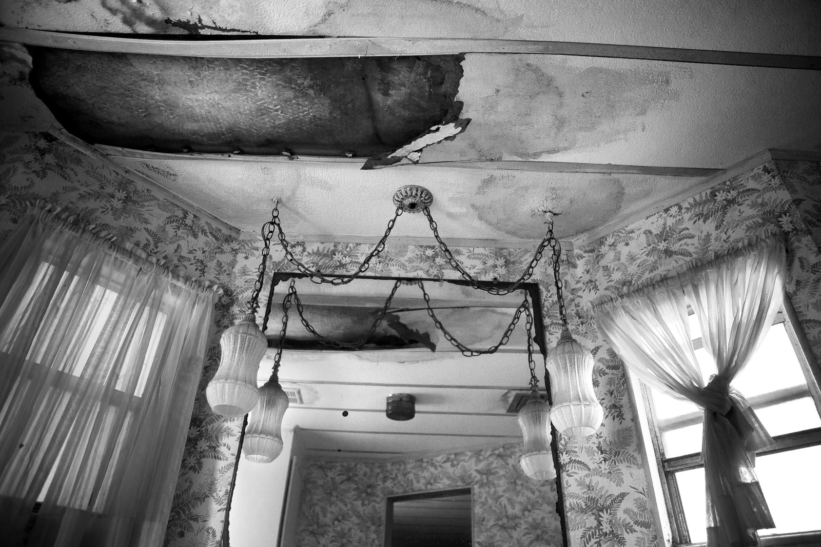 Holes in the ceiling mirror those in the floor of Charles Asaro's home in Hobe Sound. At 98-years-old Charles has been living in th3e house for nearly 40 years despite it being in desperate need of repairs.