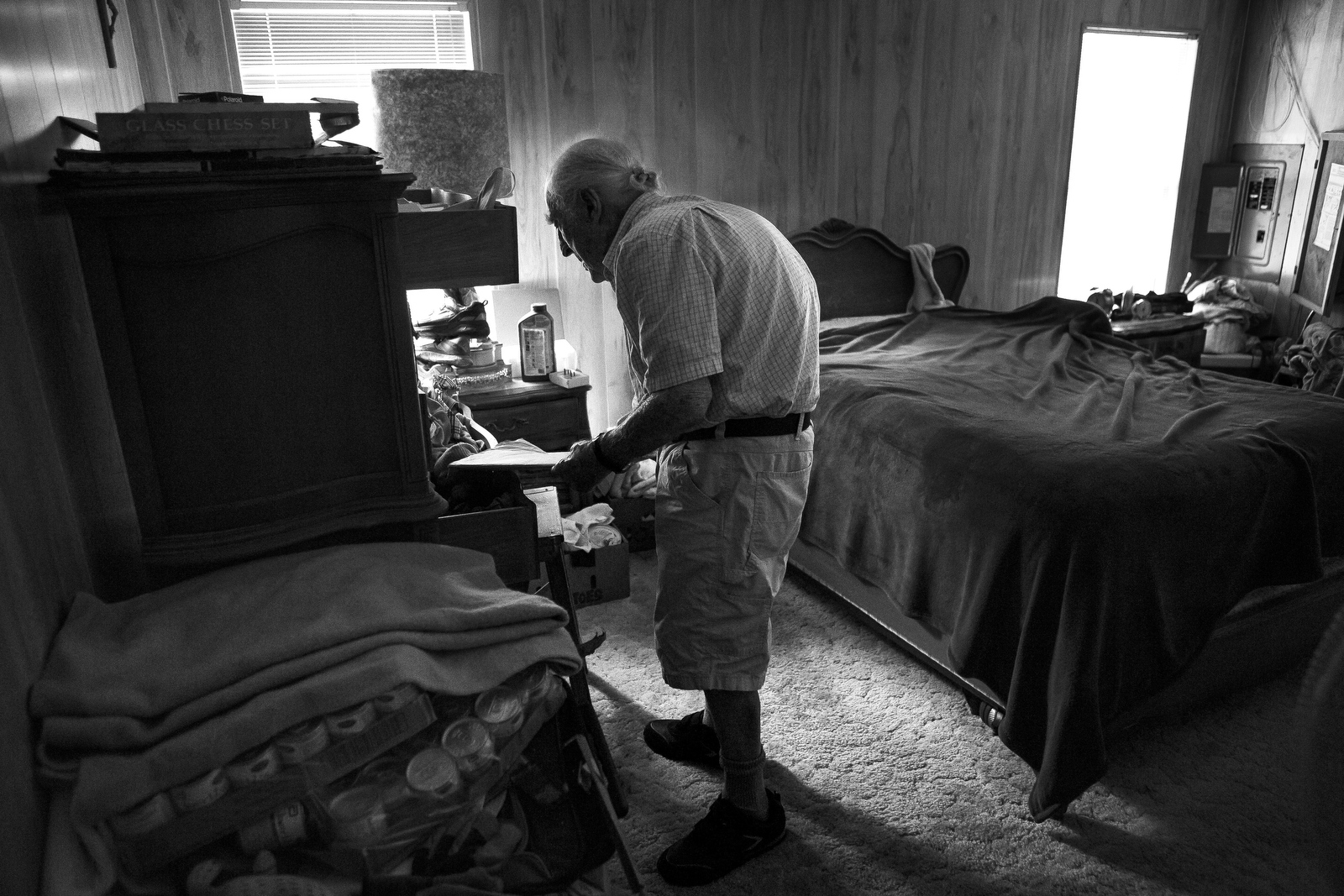 Charles Asaro, 98, stands in the bedroom of his home. He has lost much of his eyesight and although he fell into a hole in the floor of his bathroom, he would prefer to continue to live independently.