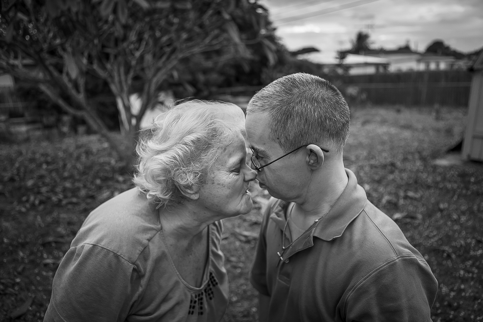 Wanna Tebby, 81,jokes around with her nephew Raymond Hommel, 49,in the backyard of their house. Wanna has taken complete care of Raymond, who has Down syndrome, since he was 14 years old. Wanna worries about both of them needing additional support as they age, but living apart is not an option.