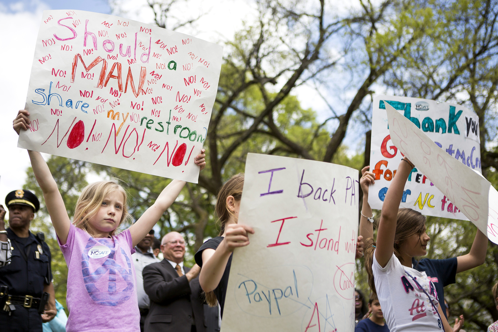 Annalise Todd, 9, of Raleigh, holds a sign in support of House Bill 2, which requires people to use the bathroom of the gender designated on their birth certificate, during a rally at the State Capitol.