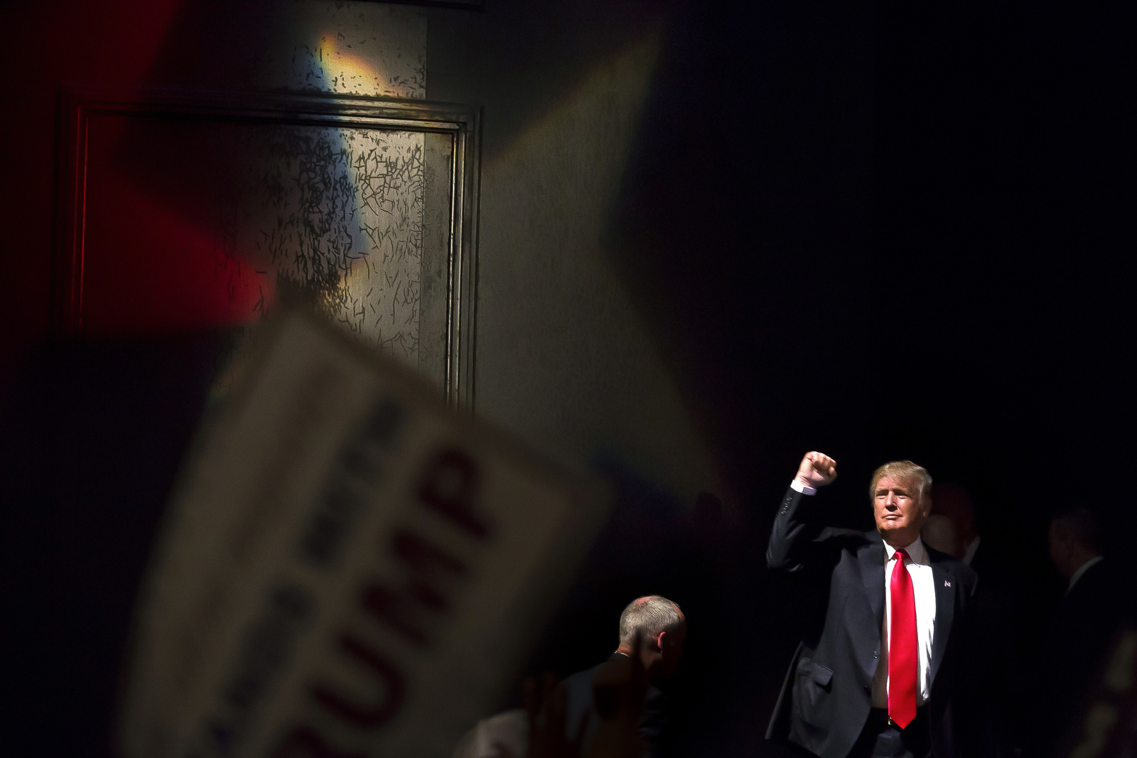 Presumptive Republican presidential nominee Donald Trump raises his fist as he leaves the stage after a rally in Raleigh.
