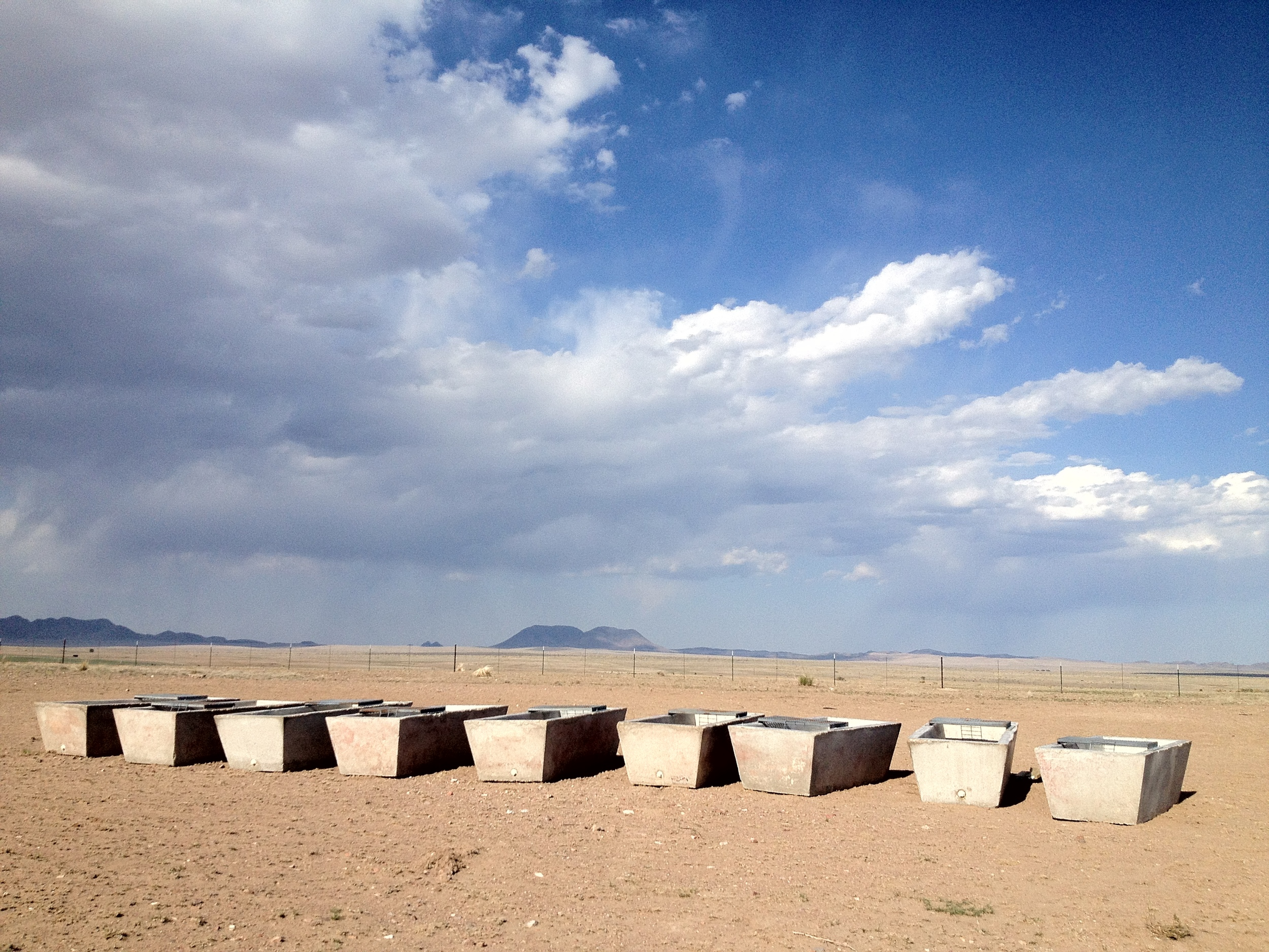 West Texas sky. These cisterns almost seem like an installation, but they are actually part of a ranch.
