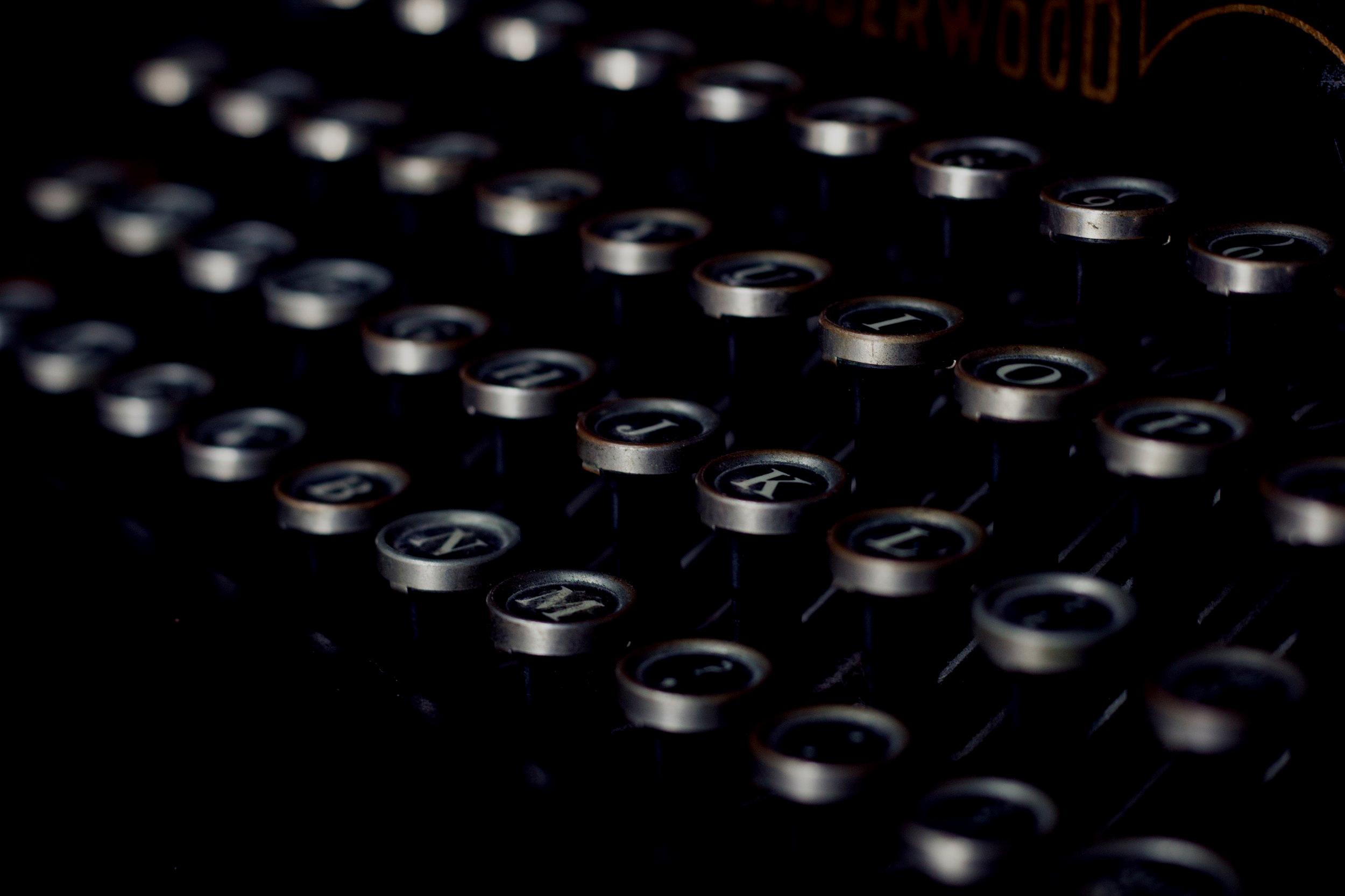podcast+typewriter+camille-orgel-58391-unsplash.jpg