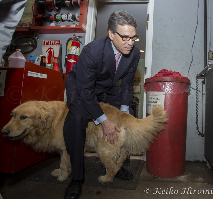 March 12, 2015 - Concord, New Hampshire, United States: Former Texas Governor Rick Perry plays with Chester, Golden retriever at Weed Automotive. Perry has yet to declare his plans for his possible run for President in 2016, but a handful of his former aides and allies launched a super PAC that can raise and spend unlimited amounts of money on his behalf.