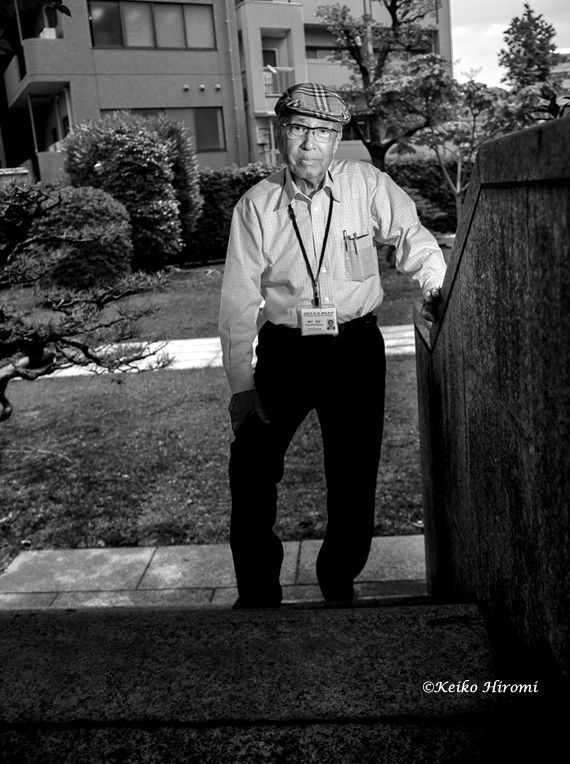 Hiroshi, photographed at   his office   stairway which   has been marked as a historical monument.