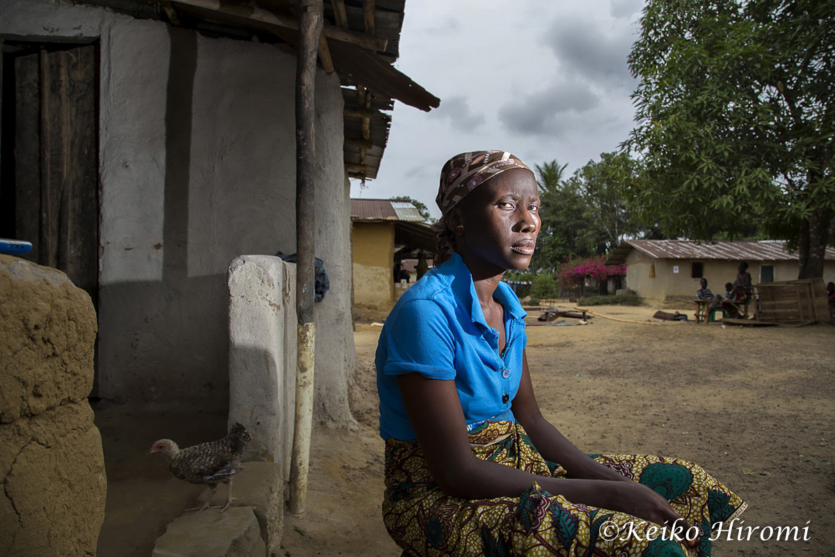 """February 21, 2015, Freeman Reserved, Todee District Montserrado County, Liberia: Ebola Survivor Mary Kollie at her rented house in Freeman Reserved, Liberia.  """"I am a permanent citizen of Freeman Reserved, with 4 children. I am living in a rented house. The house owner got sick and died on September 18, 2014 in the house where we lived. The entire members of the house were quarantined at the school building for 21 days. While we were in the school, my daughter Beatrice Beayee, 12 years got sick and was transferred to ELWA ETU and died one week later. My other two children and I got sick and taken to the same ETU. We were admitted for one month and discharged on October 2014. Since my two children and I came back home, my husband abandoned us and I do not know his whereabouts. He was afraid of us and has never come back to see us"""""""