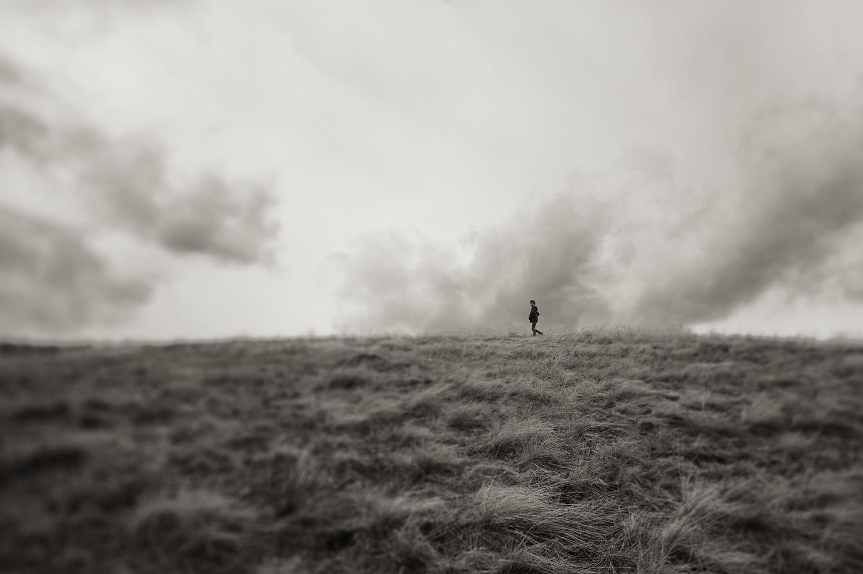 Will Price walks a ridge line. Paradise Valley, Montana