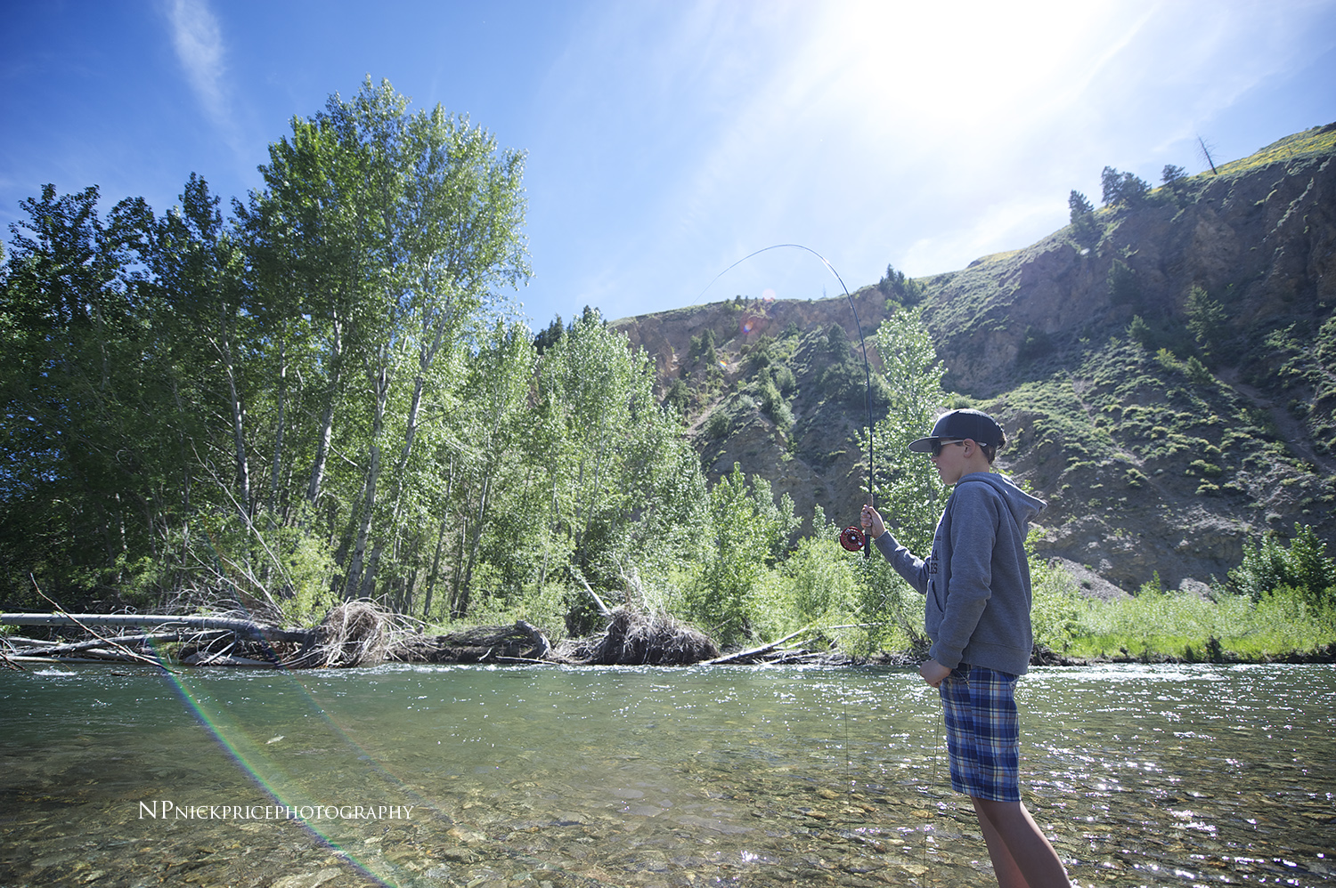 Will Price and his first solo fish. Big Wood River, Idaho. It's pretty cool to watch someone catch their first fly caught fish!