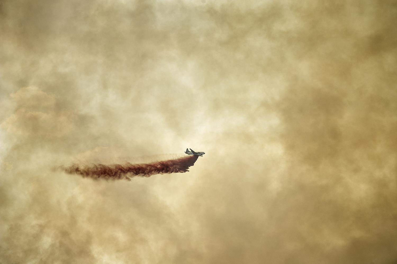 A retardant bomber unleashes near Sun Valley, Idaho.
