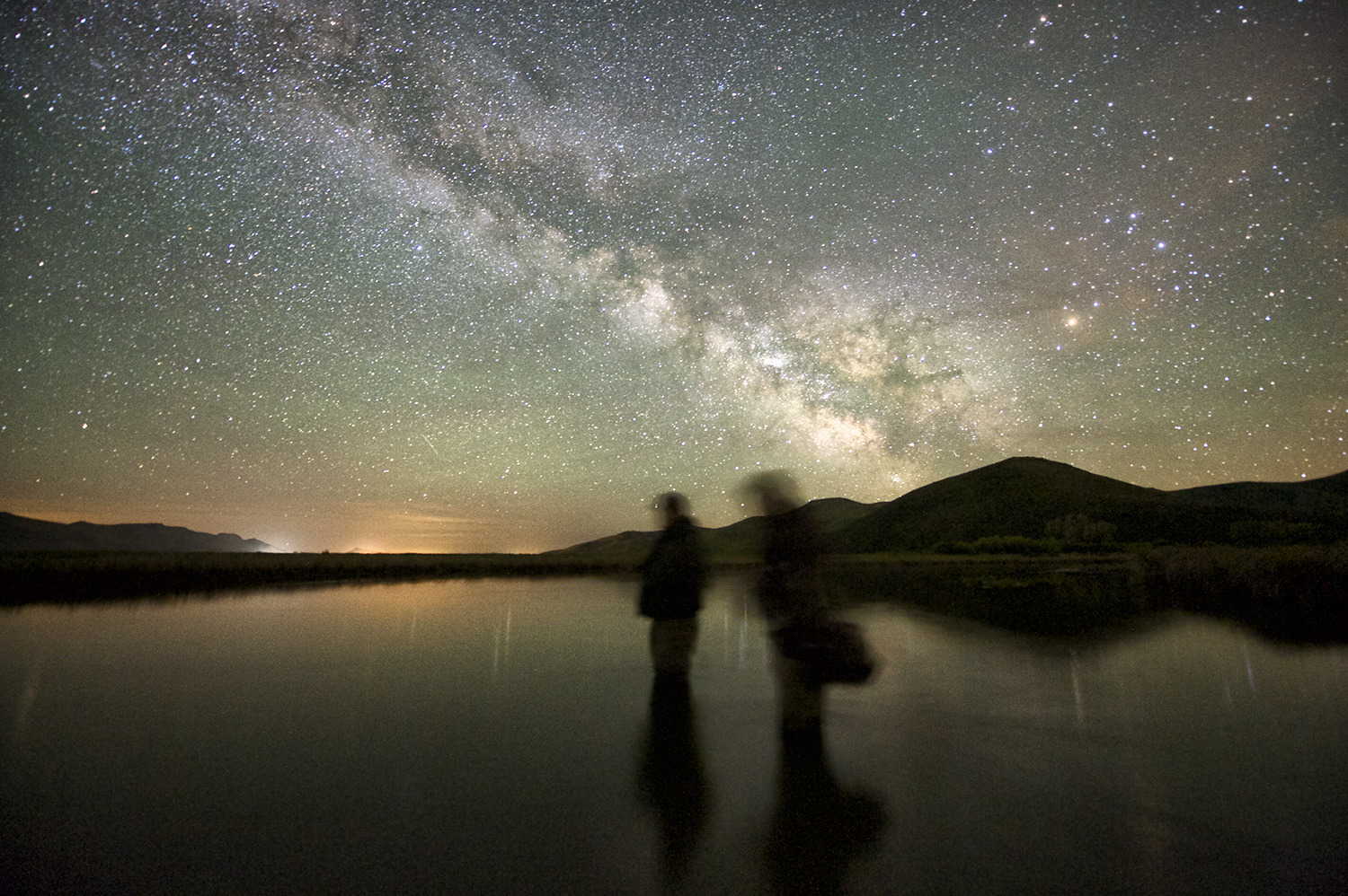 Silver Creek, two fishermen and the milky way.