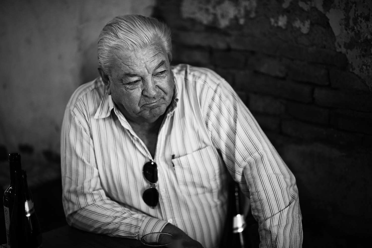 Diego Kelly of San Antonio de Areco sits in a bar during a typical Argentine lunch of Malbec and asado.