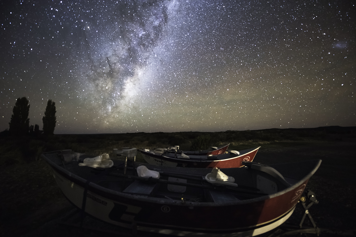 drift boats and milky way limay river.jpg