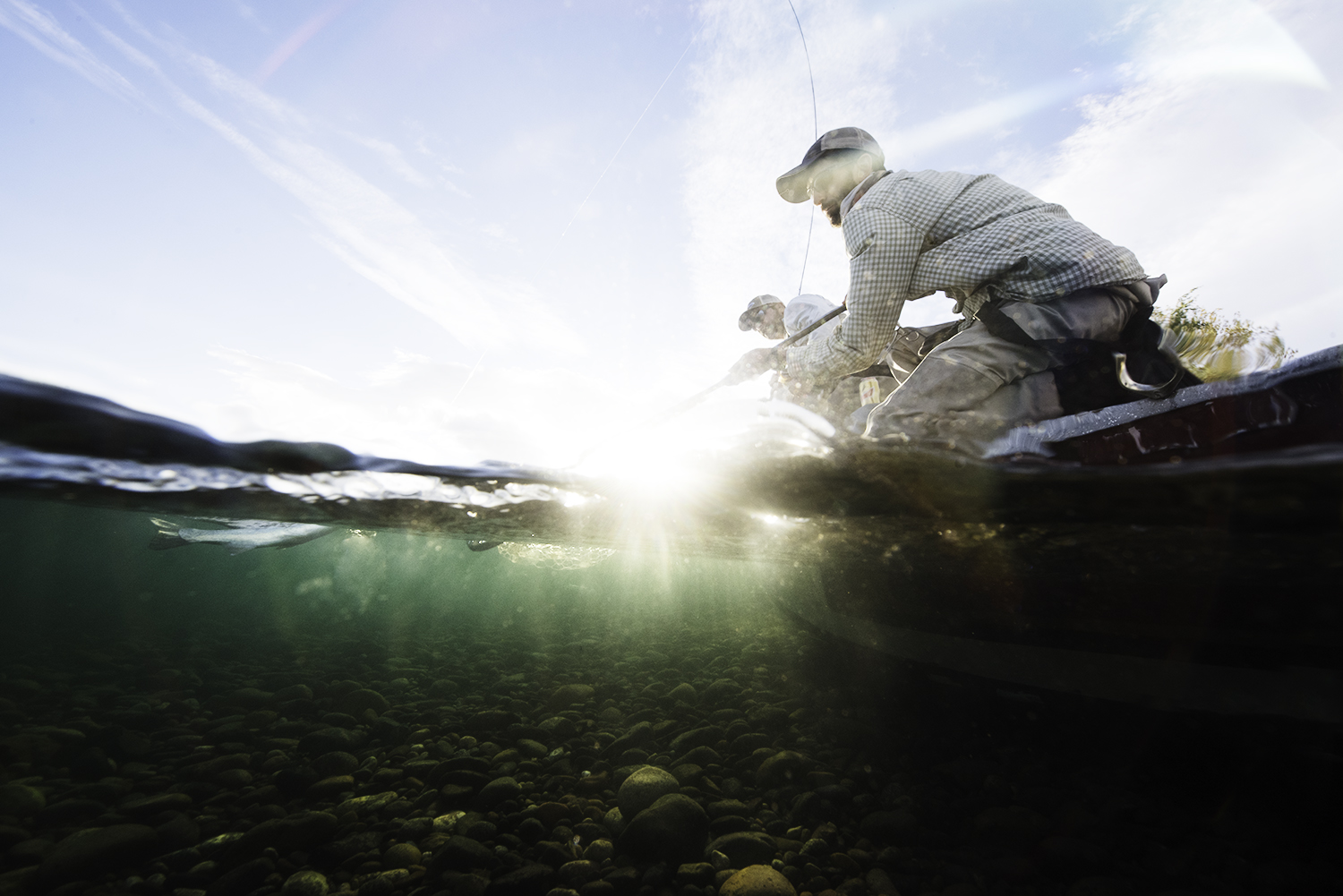 Pablo Vinaras gets the net ready a few weeks ago on the Limay River, Argentina.