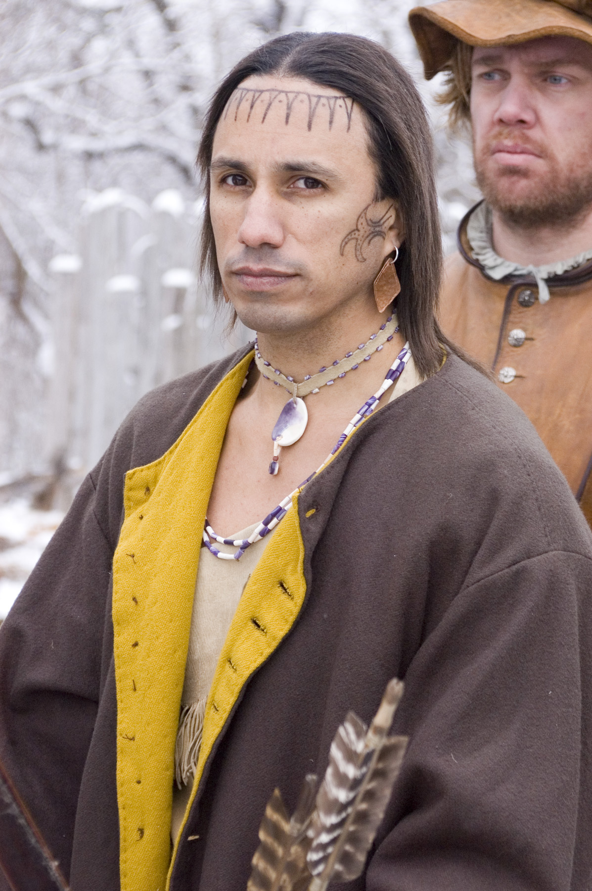"Actor (Aaron Ten Bears) portraying Samoset, the Abnaki who first approached the Pilgrims, and later introduced them to Tisquantum (""Squanto"").  Promotional image for   Desperate Crossing,   courtesy of Lone Wolf Documentary Group."