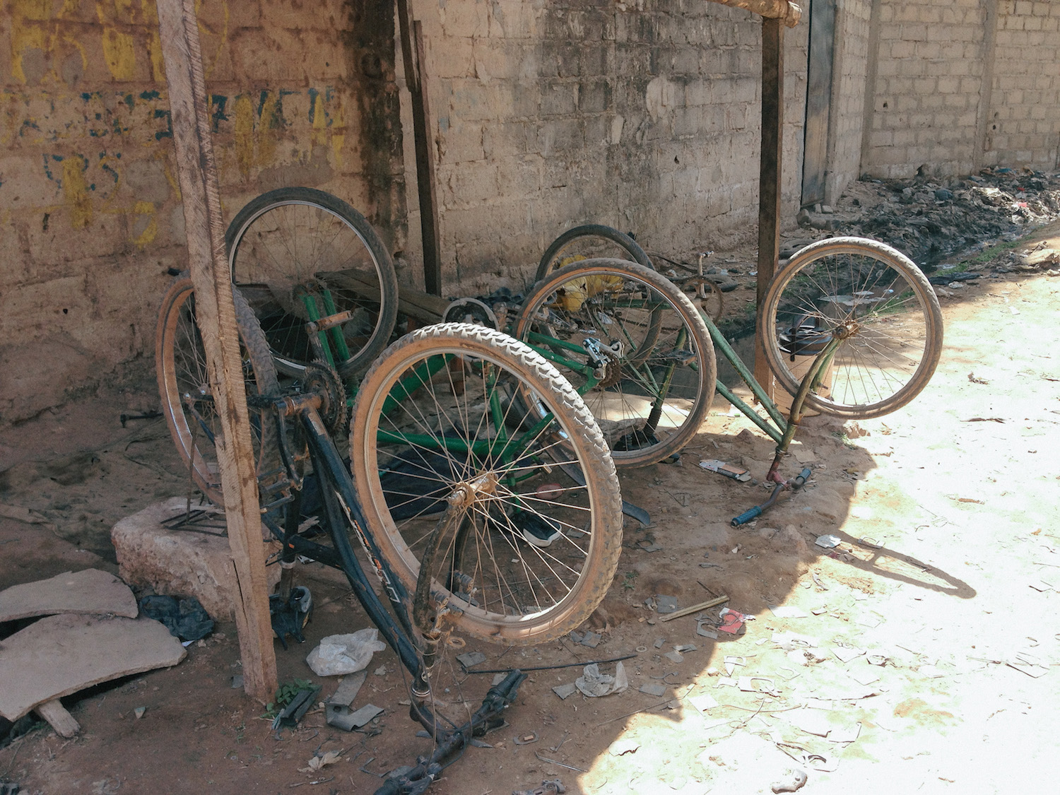 Damaged bikes on a back street in The Gambia