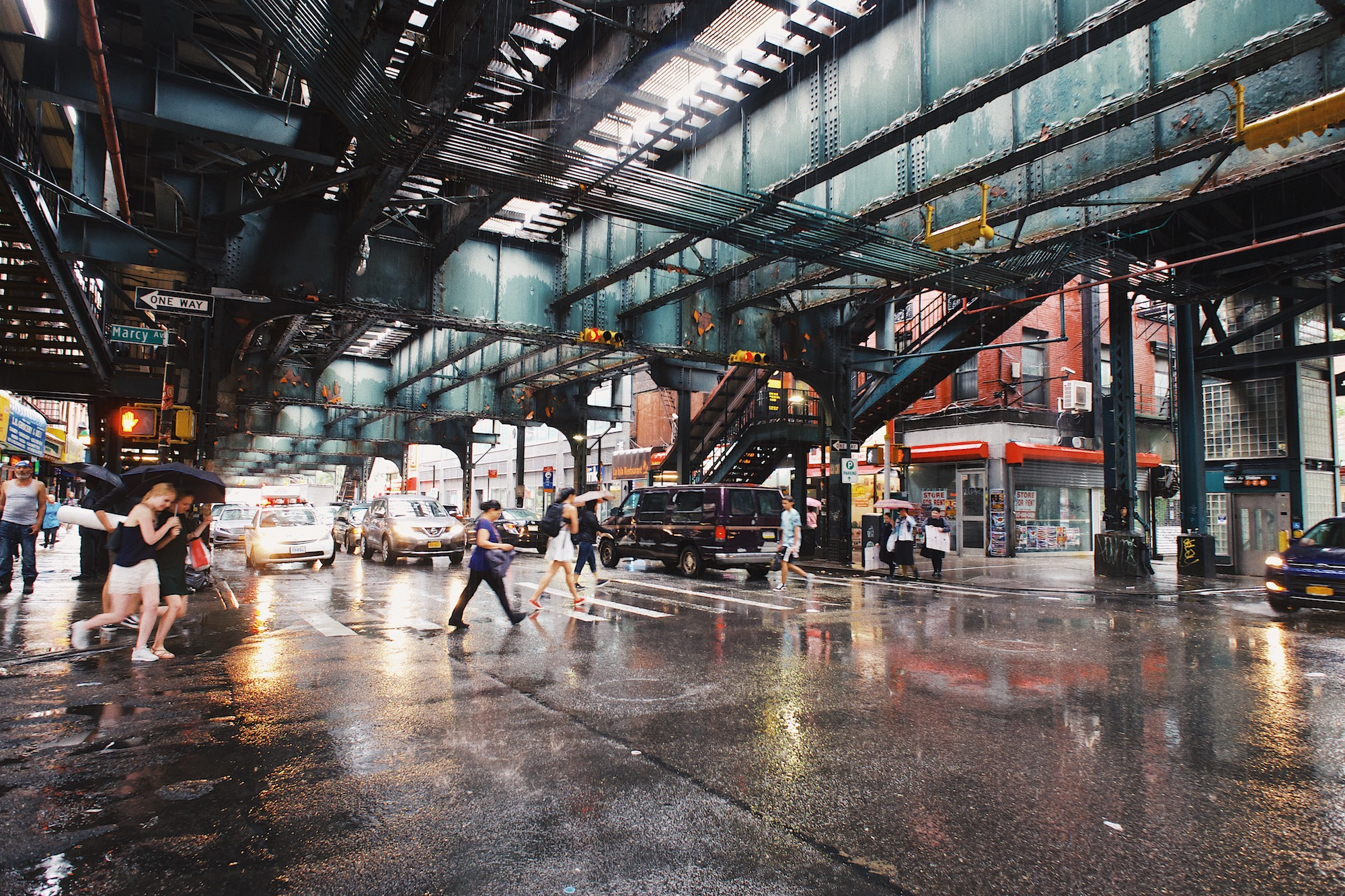 Under the metro - Wondering around BK always leads to some fantastic scenes and it definitely is a street photographers dream. The overhead subways lead to amazing light, especially at dusk or when it rains, and the diverse culture made people watching really quite fun.