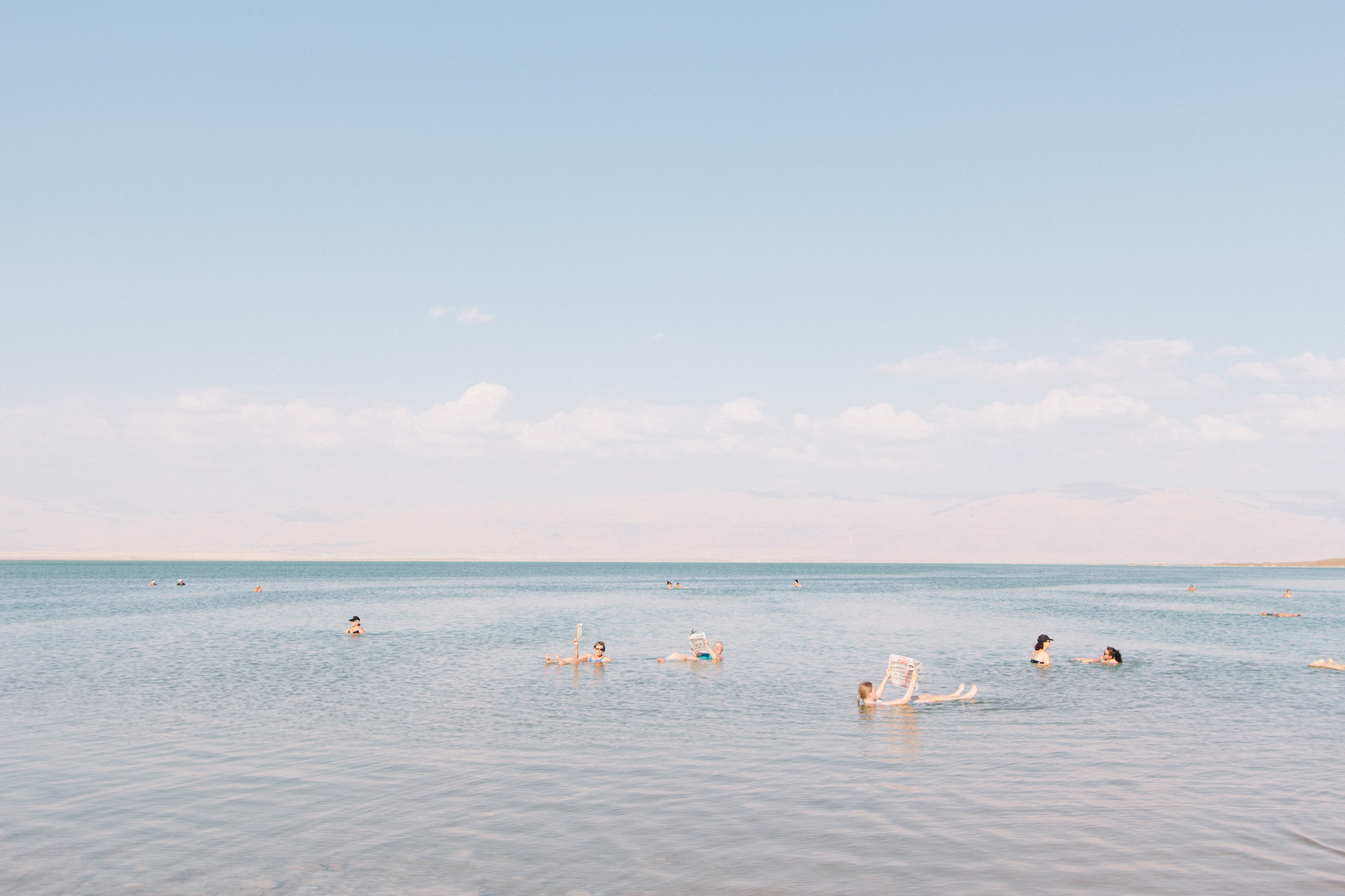 Dead Sea - Swimming in the Dead Sea is completely surreal. The salt levels are so high, the water almost feels oily and you really, really need to make sure you don't have any cuts! Of course you can also float in it and read a newspaper if you must.