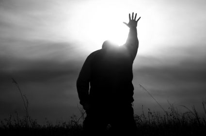 Praying person reaching for God