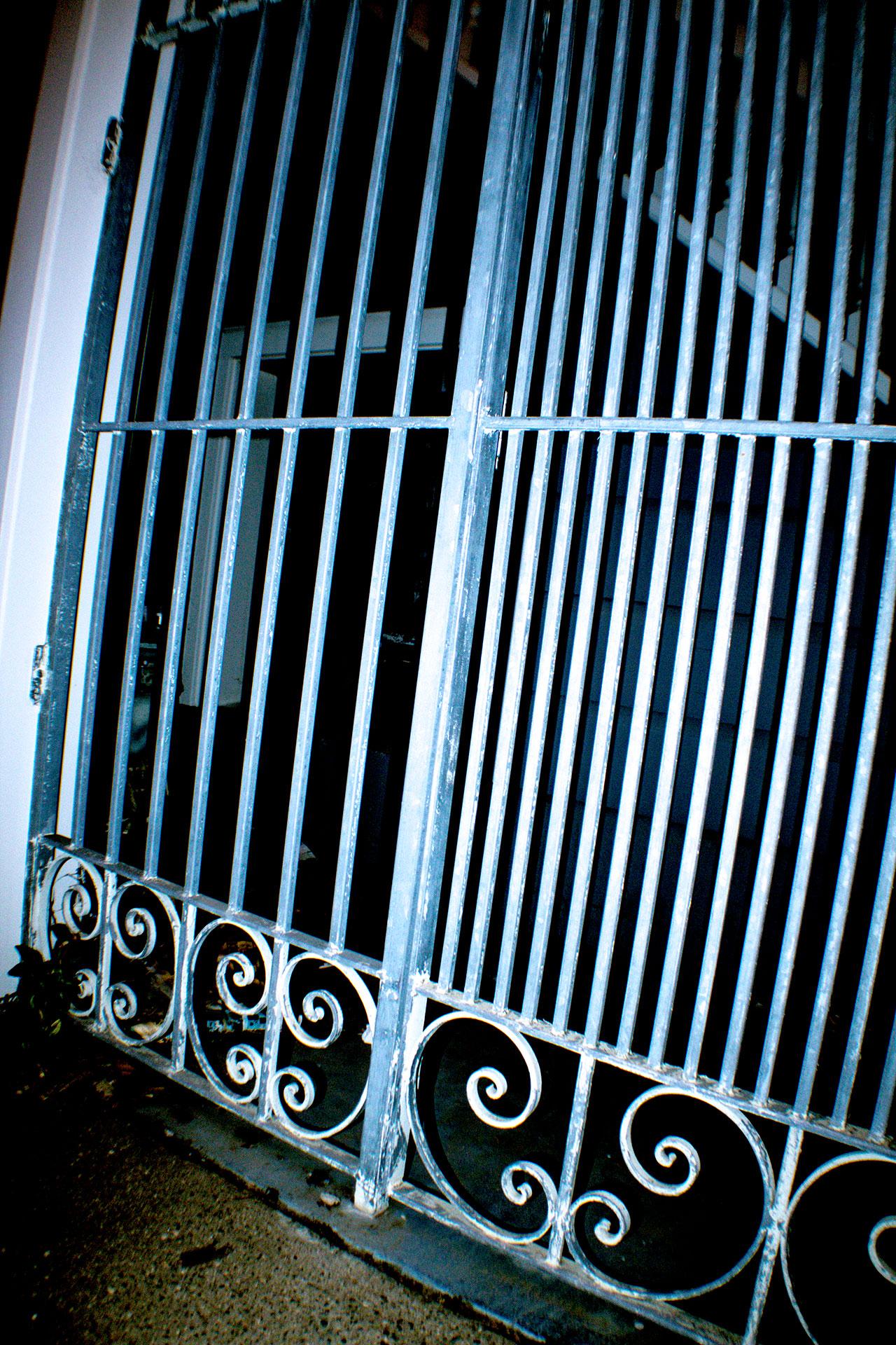 gate to a dark neighborhood
