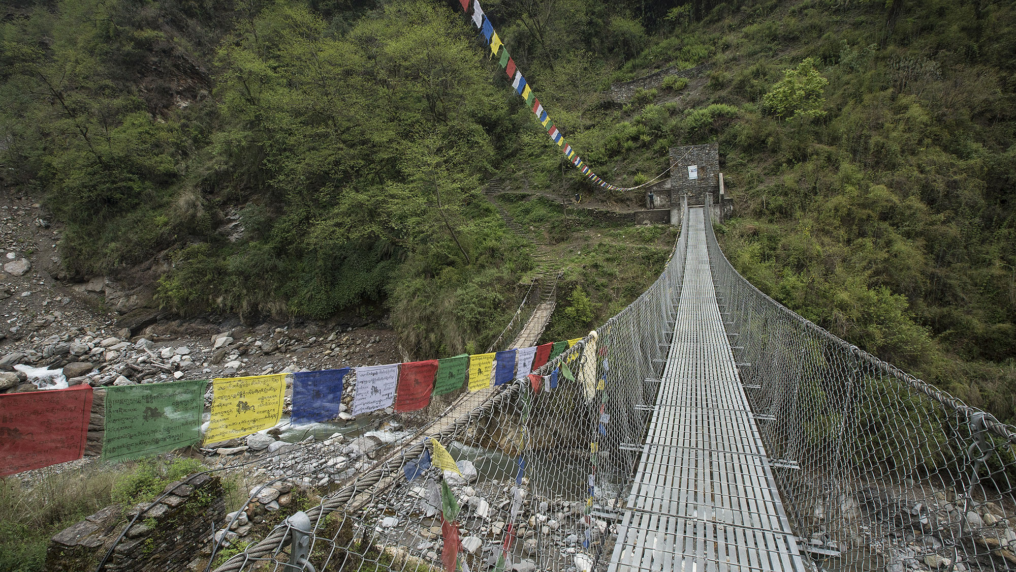 The Annapurna trek seemed more like endless steep climbs and steep descents. Often following these descents into a valley were steel cable bridges that allowed us to cross the numerous rivers that flowed through these low points.