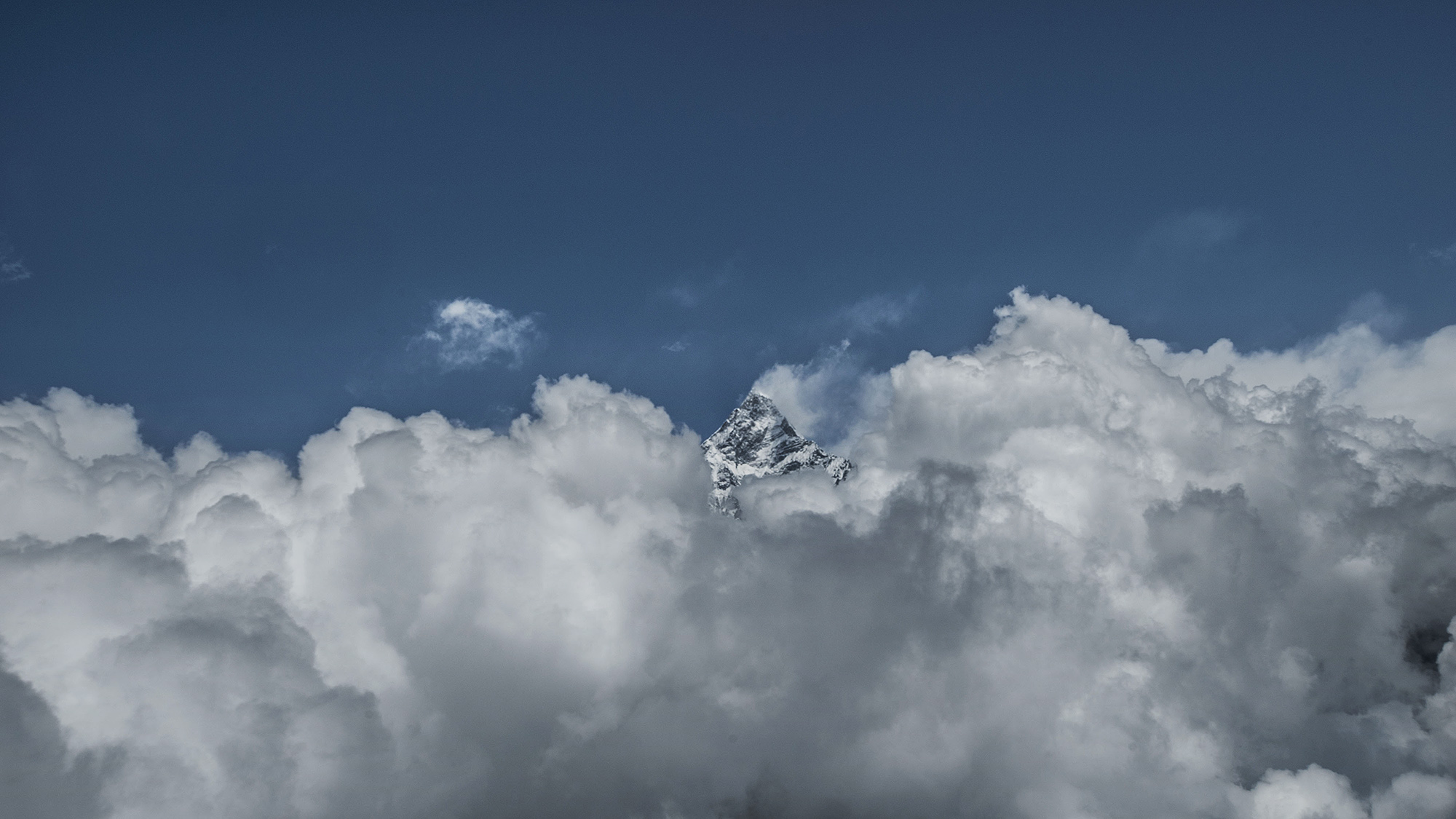 "Machhapuchchhre aka ""The Fish Tail"" poking its head above the clouds at 6993m."