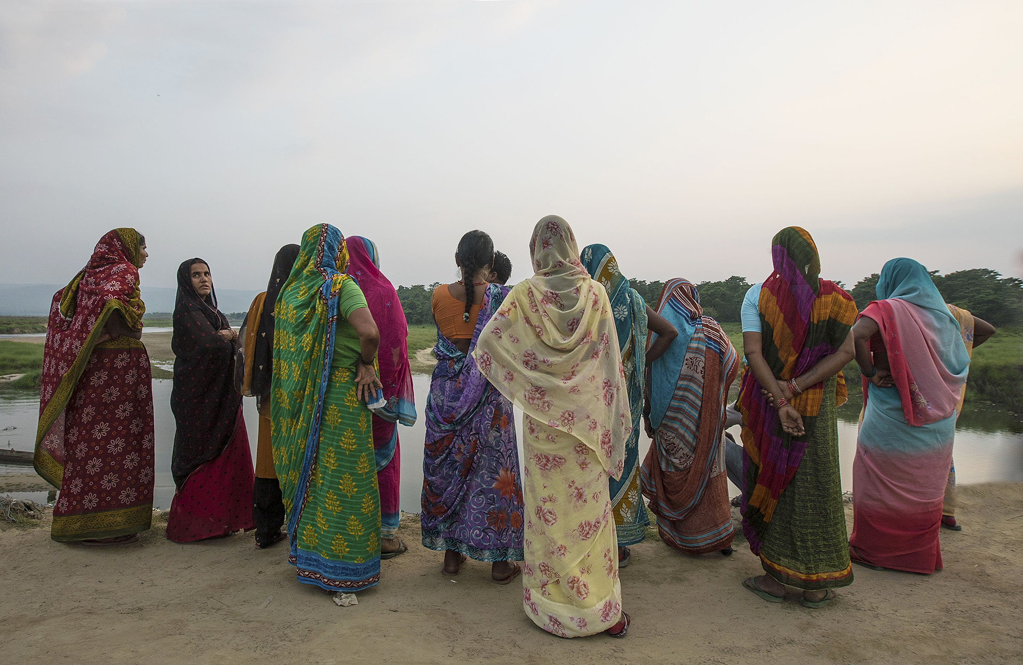 Local nepali women look onto theRapti river of Chitwan National Park.