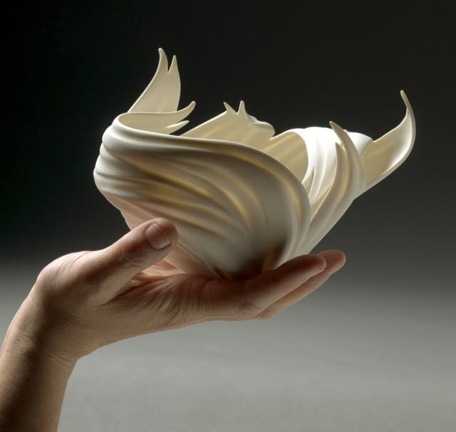 Jennifer McCurdy Flame Vessel in Hand 5x7x5   Photo by Gary Mirando 2010.jpg