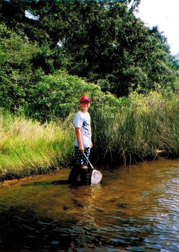 Reid collecting organisms in the vicinity of Dead Man's Island, Pensacola Bay, Florida.