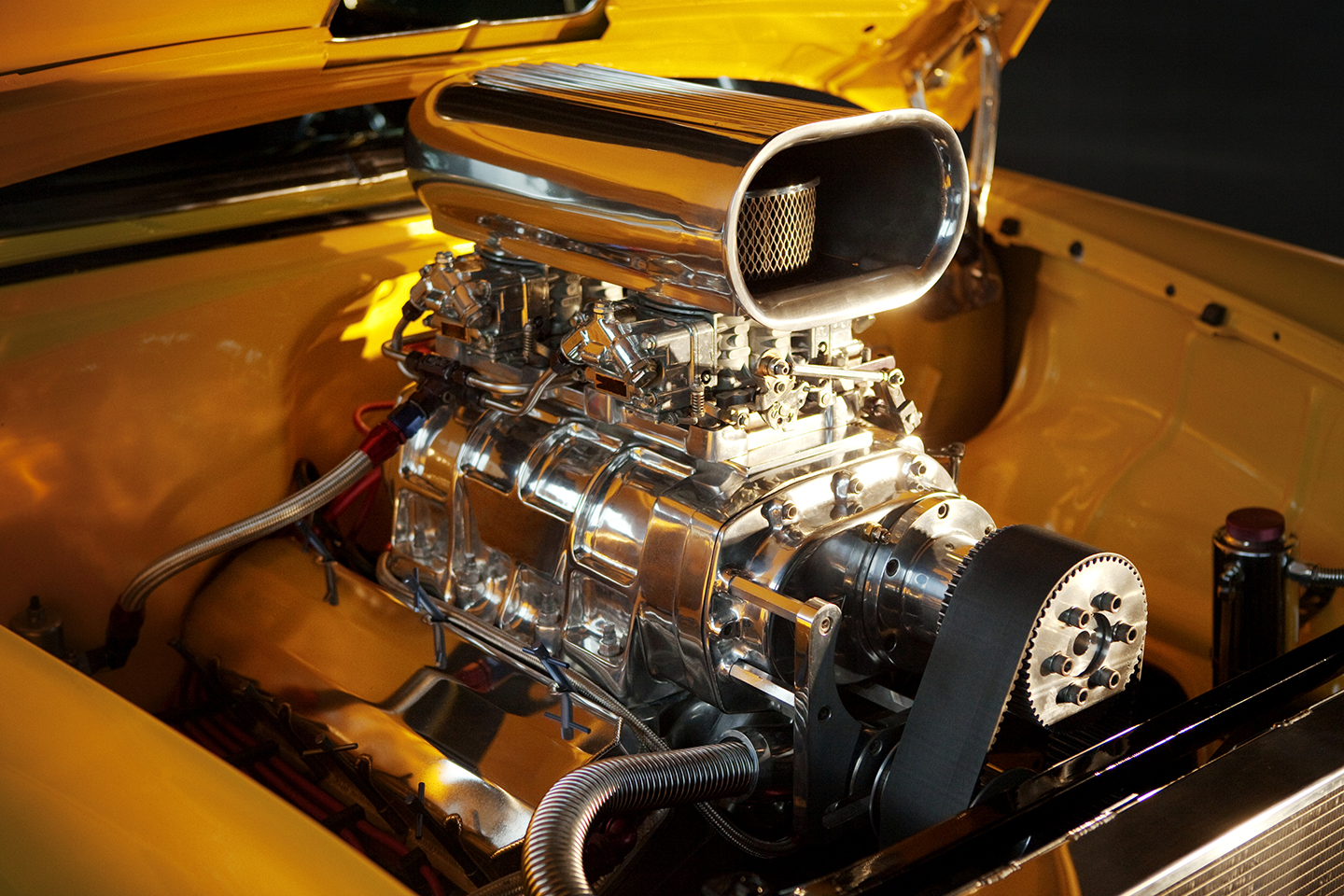The New Engine of a 1955 Yellow Chevy