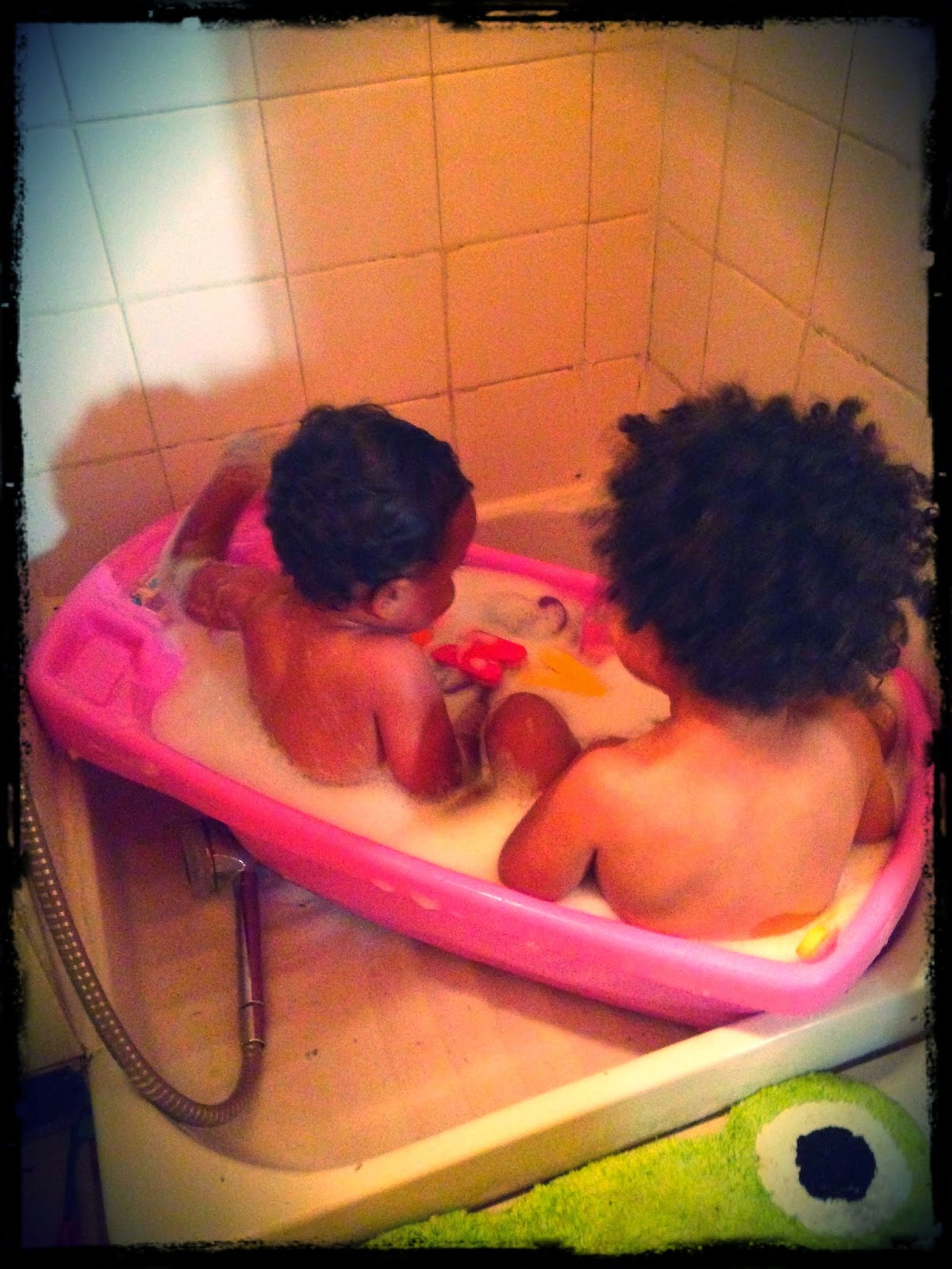 Infant tub for two toddlers? At least they get clean!