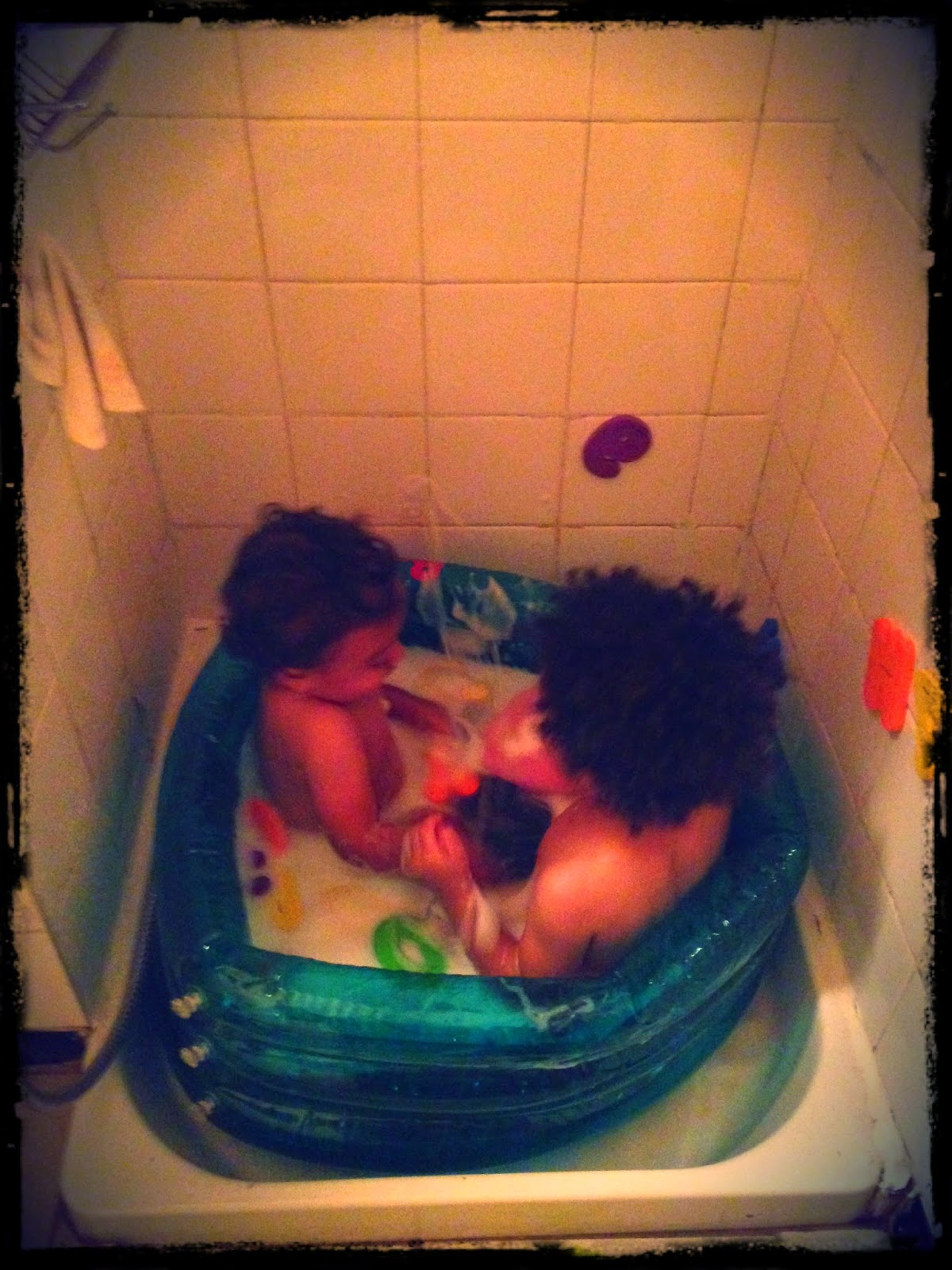 This toddler tub isn't really that much bigger, but it does allow for more water. And...it's usually just one kiddo in there at a time. This night they insisted on taking a bath together