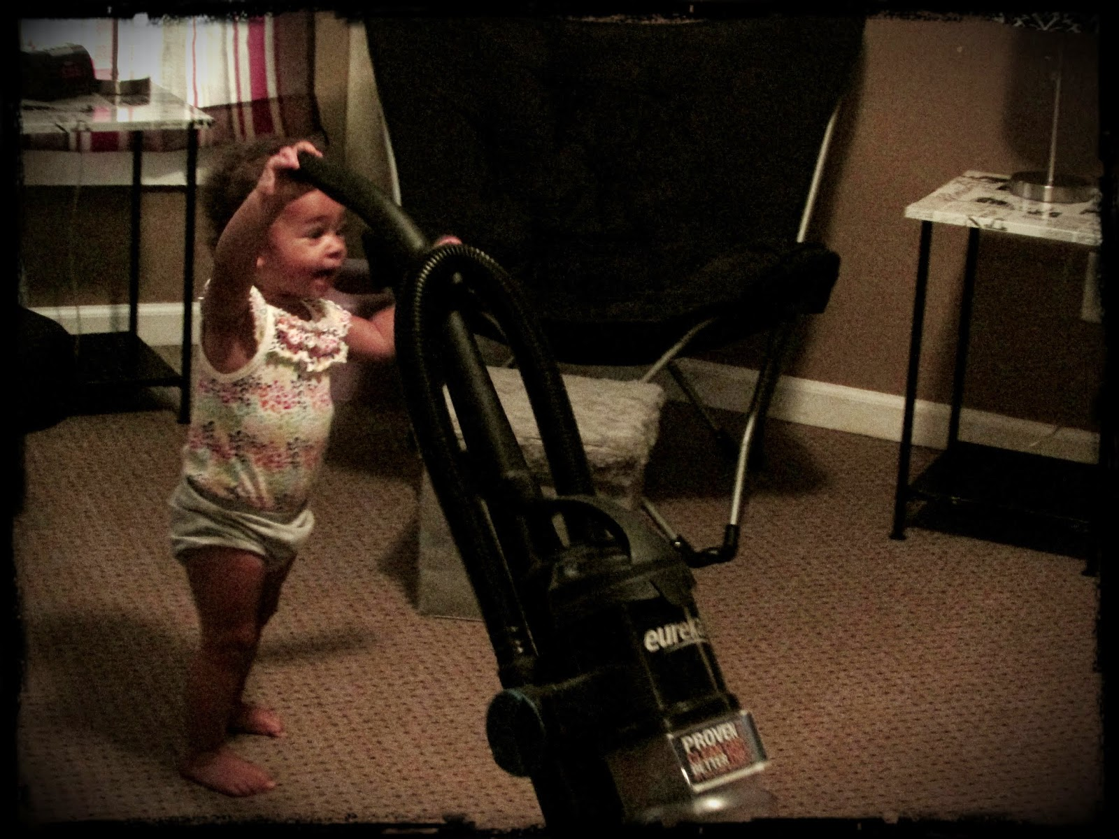 Vacuuming isn't really Miss Fits daily routine. But...it was fun to watch her try. And it's a cute picture!