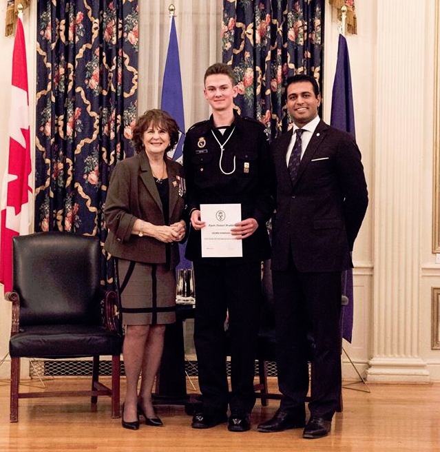 Cadet Brakke receiving his Silver award from the Honourable Lois Mitchell, the Lieutenant Governor of Alberta.