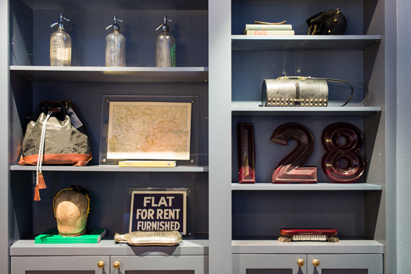 Bookcases with knickknacks at Flat 128