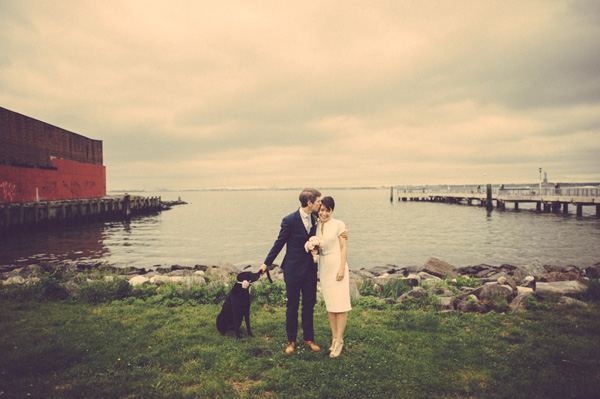 Bride and Groom with dog in front of lake
