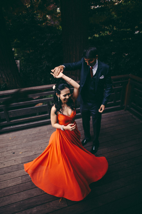 Bride twirling in red dress