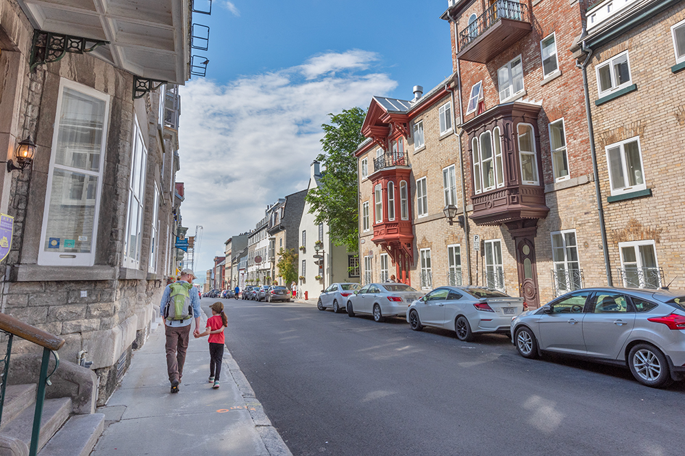 Strolling down one of Quebec's lovely streets.