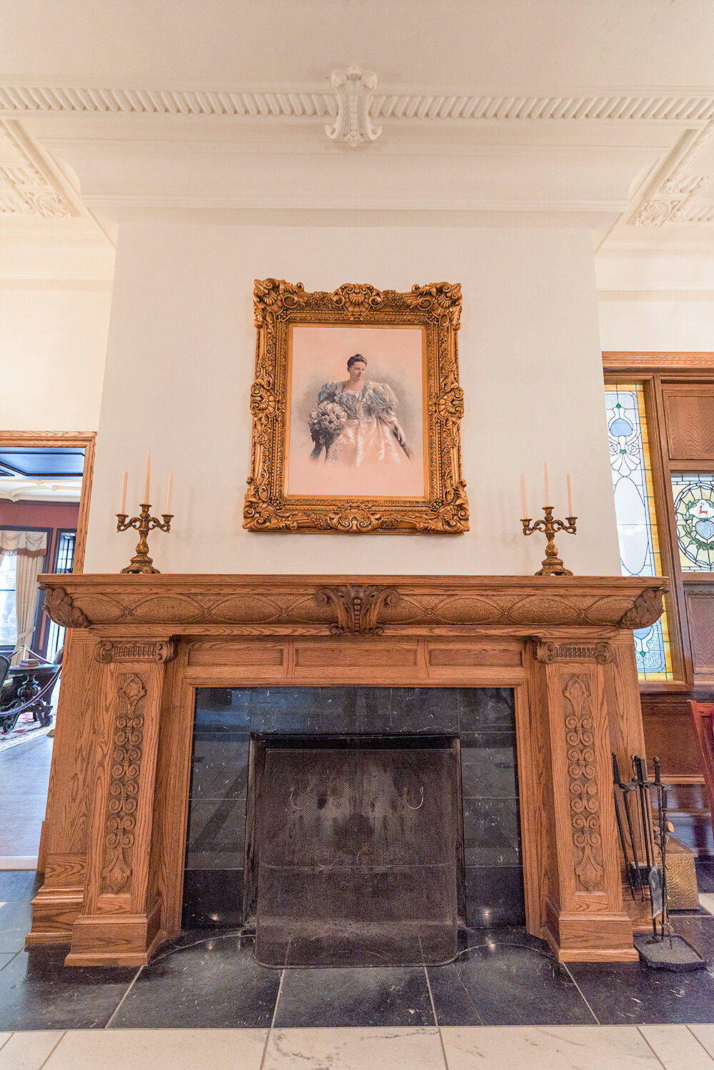 A portrait of Louise Boldt hangs over the fireplace.