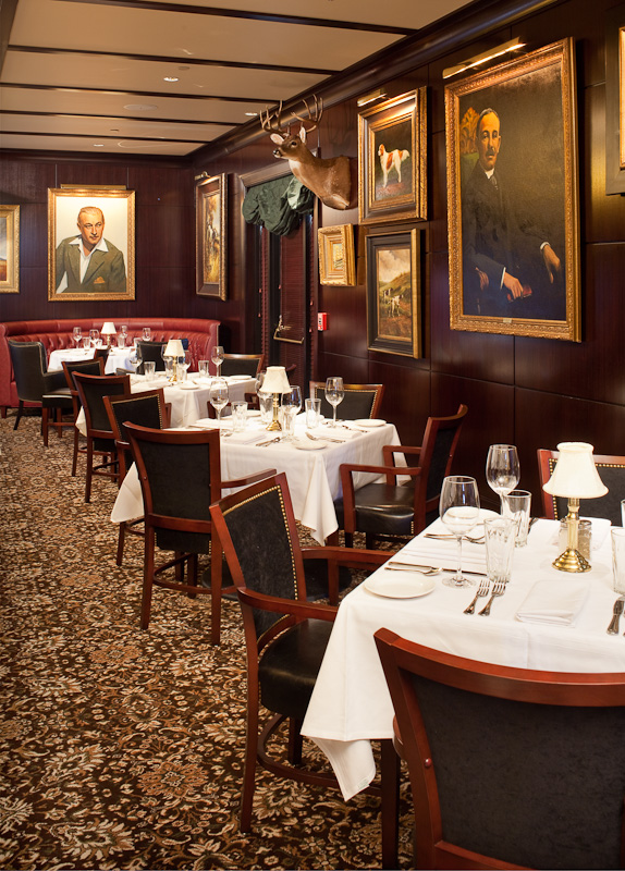 Dark paneled rooms give Capital Grille an old school cozy feeling.