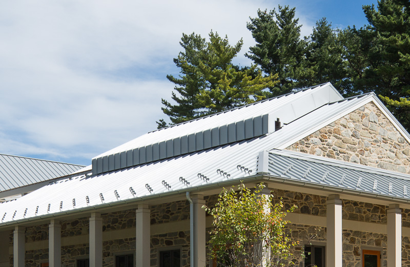 The metal roof of the meetinghouse uses motors to slide open.