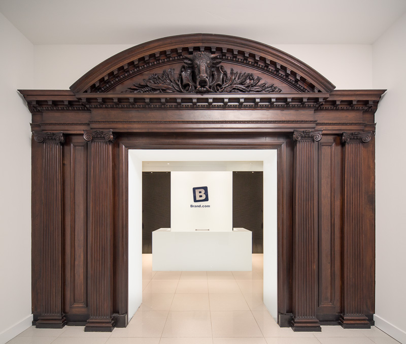 Historic wood pediment frames the doorway to the digital firm Brand.com.