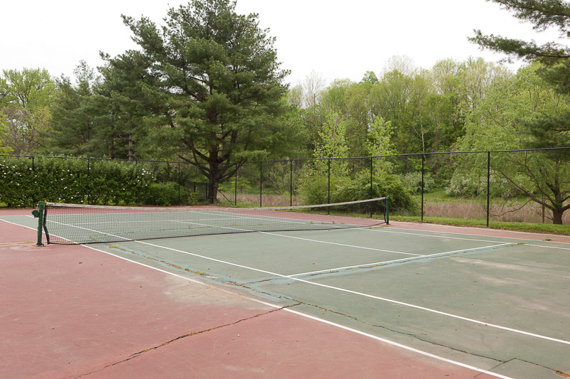 BEFORE: The old tennis court was poorly maintained and under-utilized.
