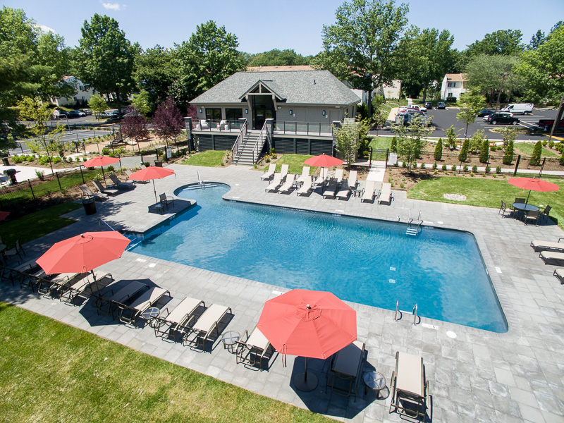The sparkling swimming pool and inviting common areas beg for a late-summer party!