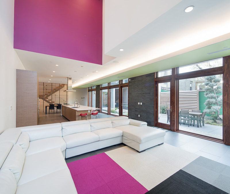 The dramatic geometries of the home's facade are continued inside, with a spacious and airy modern design.