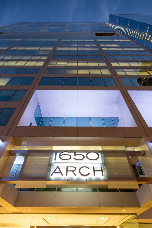 Striking angles are accented by glowing windows at dusk. 1650 Arch Street, Philadelphia.
