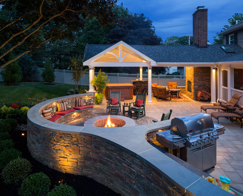 Get ready to toast s'mores (or a glass of wine!) by the firepit in this elegant outdoor entertaining area.