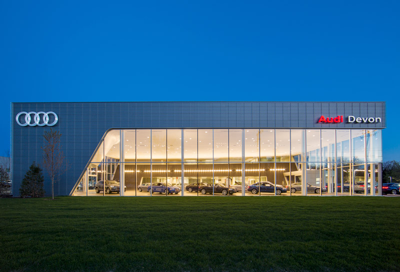 At twilight, the showroom glows like a jewel box.