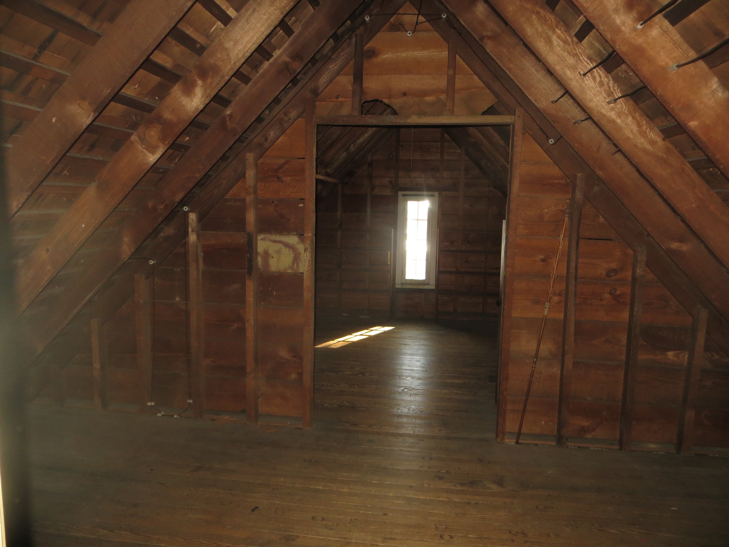 The unfinished attic before its transformation.