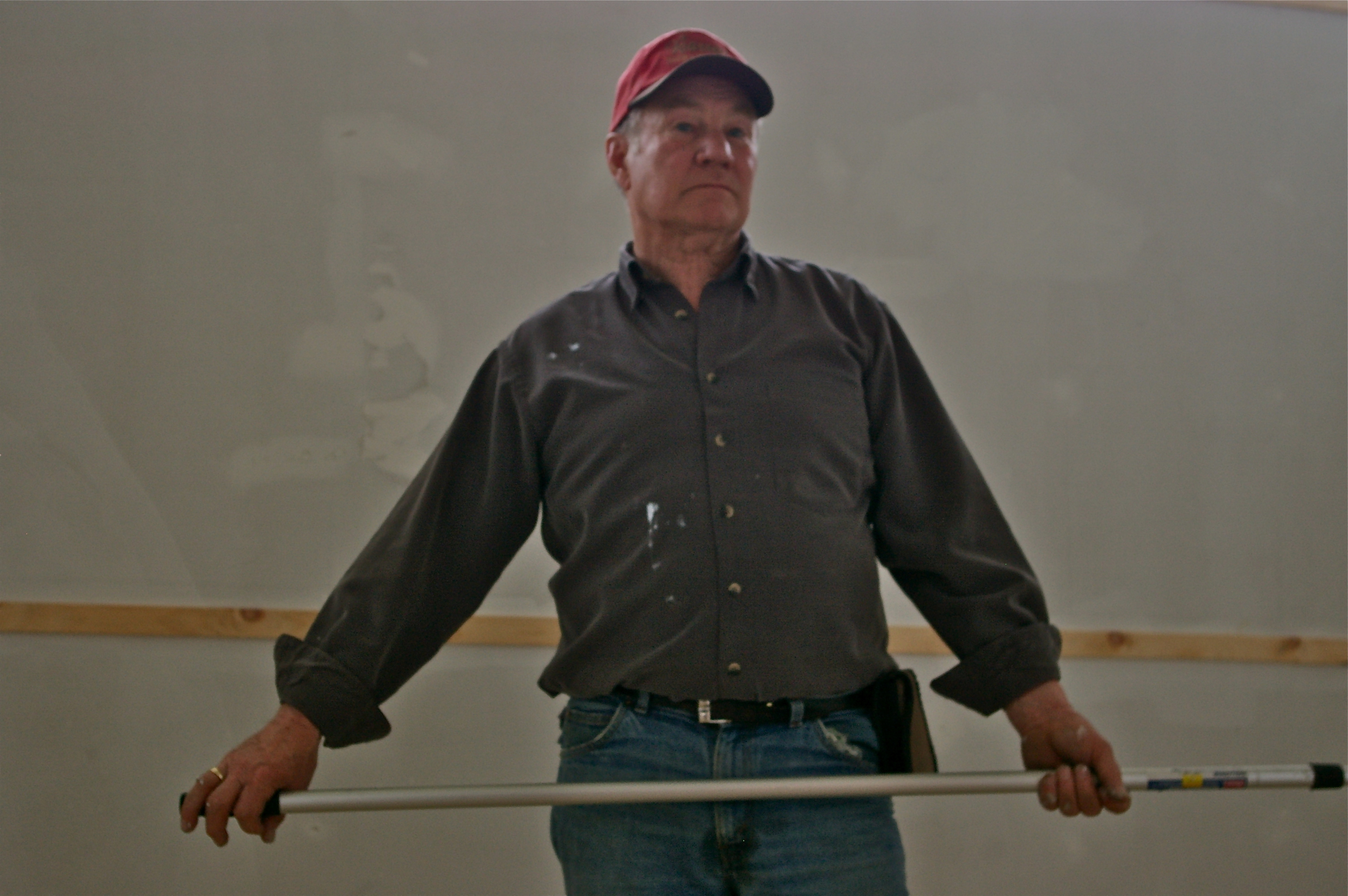 Harry Danford paints the Hastings County Building in Heritage Village.