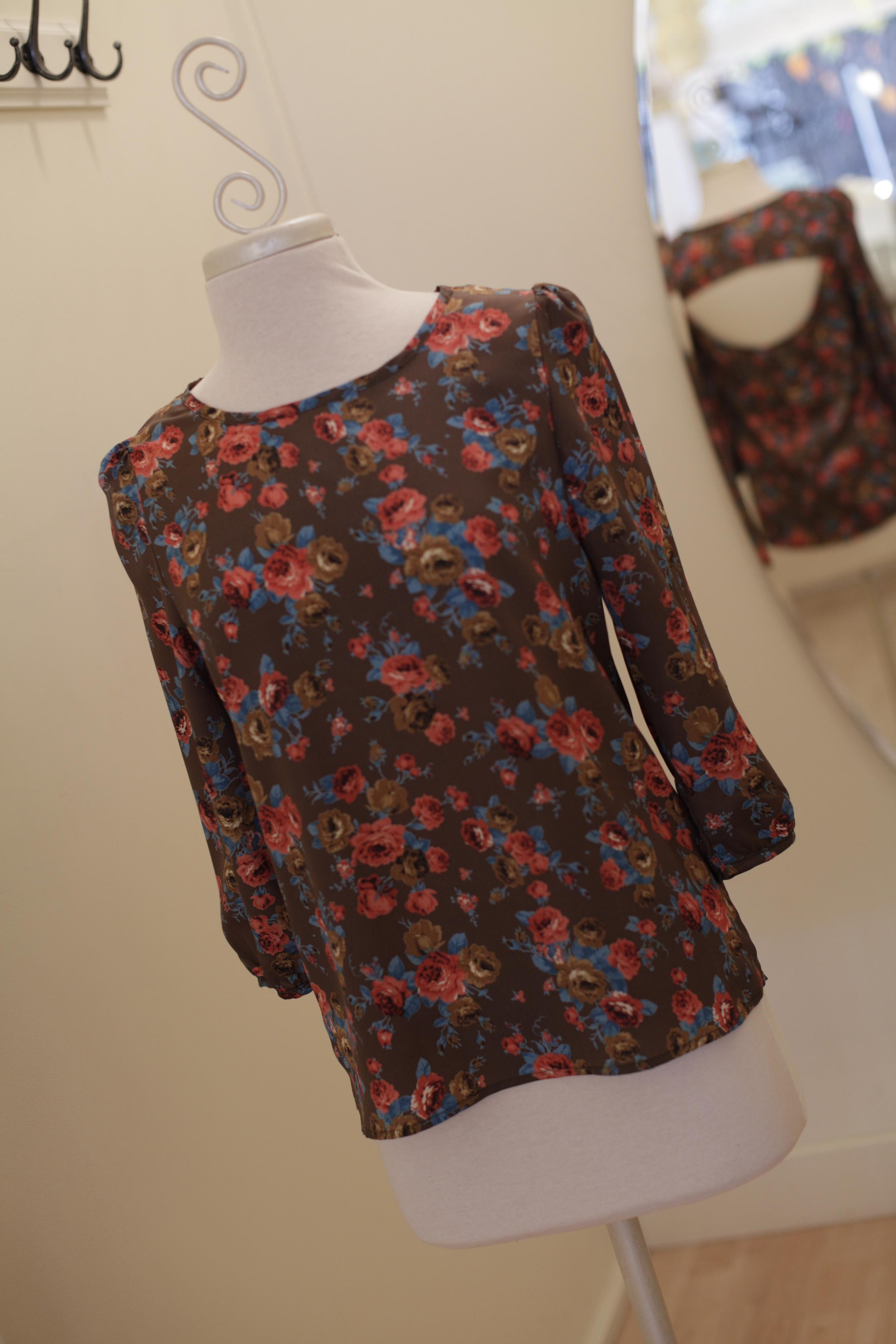 We are LOVING the vintage floral pattern of this beautiful blouse. Did you happen to notice the sexy cut-out back? What is not to love about this cutey?